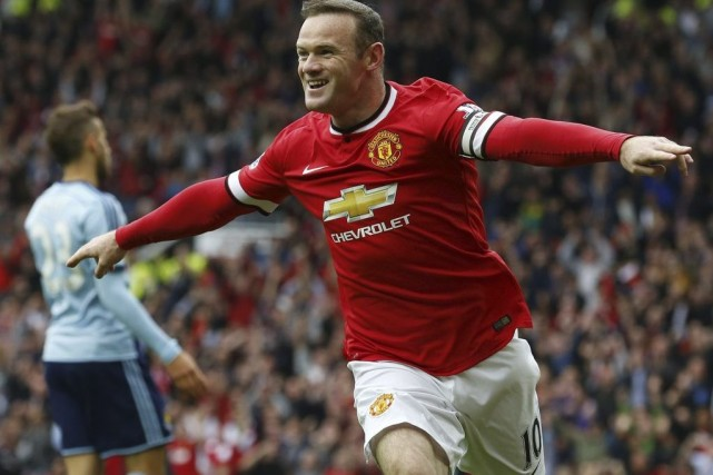Wayne Rooney a marqué son 176e but en... (PHOTO LINDSEY PARNABY, AFP)