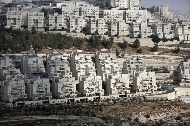 Quelque 200 000 Israéliens habitent des quartiers de... (Photo: AFP)