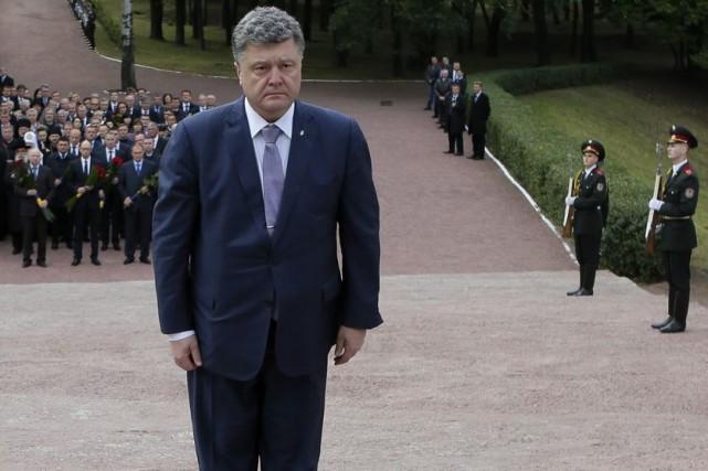 Selon un sondage effectué du 12 au 21... (PHOTO SERGEI CHUZAVKOV, ASSOCIATED PRESS)