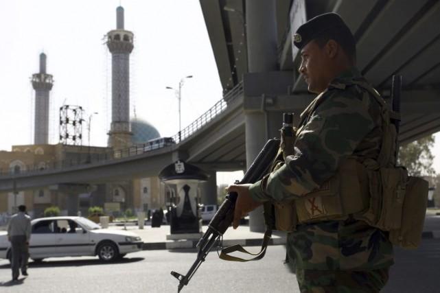 Un soldat irakien.... (PHOTO HAIDAR HAMDANI, AGENCE FRANCE-PRESSE)