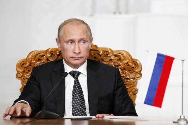 Vladimir Poutine croit qu'il faut en premier lieu... (PHOTO B.RENTSENDORJ, ARCHIVES REUTERS)