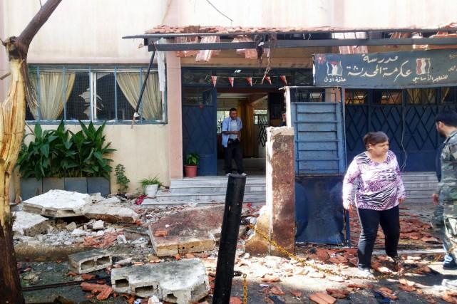 Le double attentat, dont l'un perpétré par un... (PHOTO AFP/SANA)