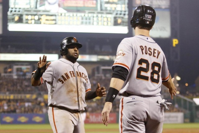 Brandon Crawford a claqué un grand chelem en quatrième et les Giants ont défait... (Photo USA Today Sports)