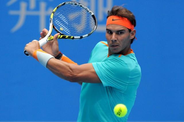 Rafael Nadal a accédé aux quarts de finale... (Photo Wang Zhao, AFP)