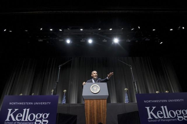 Le président Barack Obama a vanté jeudi son bilan économique, accusant les... (Photo AFP)