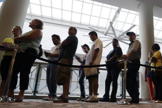 L'emploi a progressé au pays pour le deuxième... (Photo Mel Evans, AP)