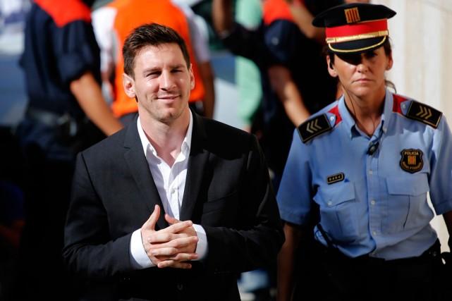 Lionel Messi et son père sont soupçonnés d'avoir... (Photo Emilio Morenatti, archives AP)