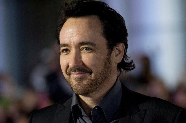 John Cusack... (PHOTO ARCHIVES PC)