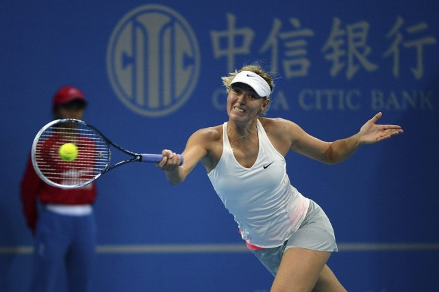 Maria Sharapova... (PHOTO GOH CHAI HIN, AFP)