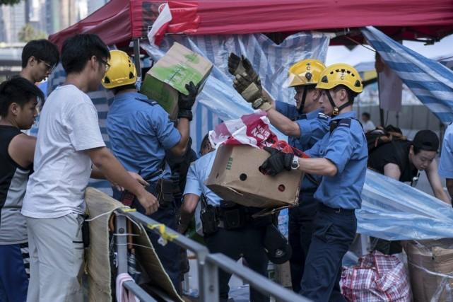 Sur le terrain, si certains manifestants plient bagage,... (Photo Alex Ogle, AFP)