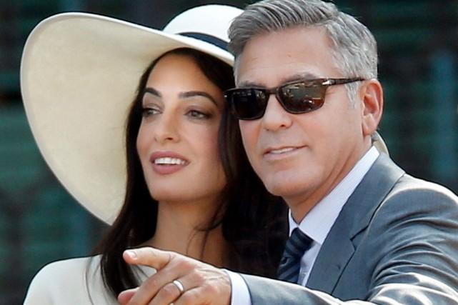 Amal Alamuddin et George Clooney... (Photo AP, Luca Bruno)