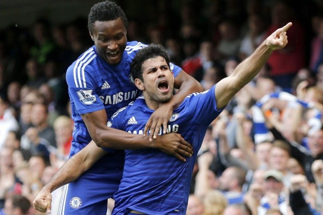 Diego Costa (devant) célèbre son but en compagnie... (PHOTO STEFAN WERMUTH, REUTERS)
