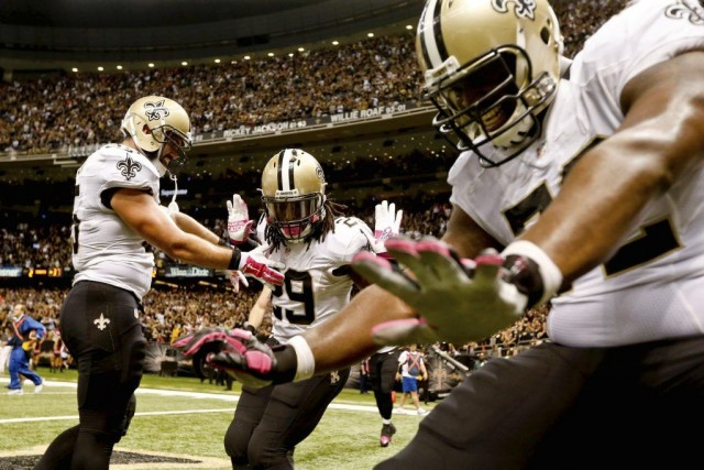 Khiry Robinson (29), Austin Johnson (35) et Terron... (PHOTO DERICK E. HINGLE, USA TODAY)