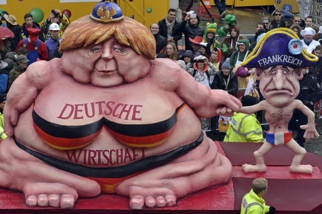 L'économie allemande, caricaturée ici par une Angela Merkel... (PHOTO MARTIN MEISSNER, ASSOCIATED PRESS)