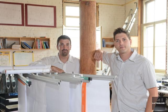 Mathieu Chagnon (à gauche), président de Rackam, et... (PHOTO JULIEN CHAMBERLAND, LA TRIBUNE)