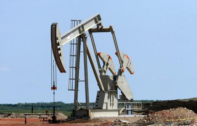Les cours du pétrole coté à New York ont clôturé à leur plus bas niveau depuis... (Photo archives AFP)