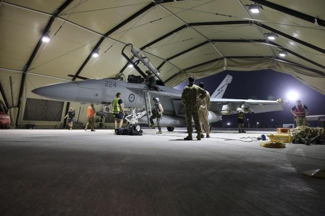 Un avion de chasse de la force aérienne australienne a effectué un premier... (Photo REUTERS)
