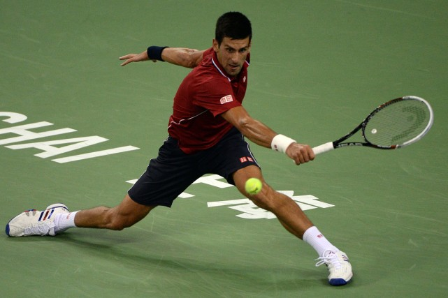 Novak Djokovic a prolongé à 27 sa série... (Photo Goh Chai Hin, AFP)