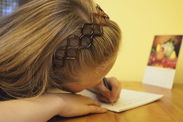 Selon une étude australienne, l'impact des devoirs sur... (photo Maxime Sauvage)