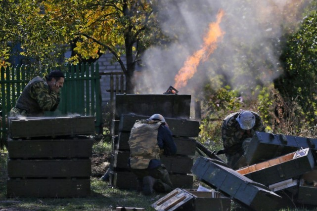 Kiev accuse la Russie d'avoir armé les rebelles... (Photo Dmitry Lovetsky, AP)