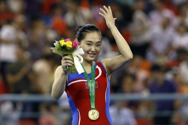 Hong Un Jong... (Photo Andy Wong, AP)