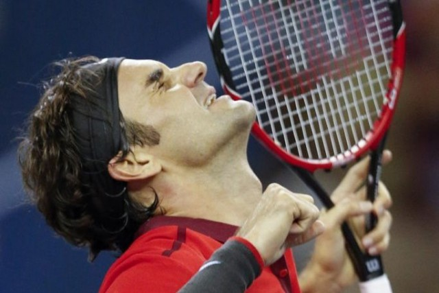 Roger Federer... (Photo Vincent Thian, AP)