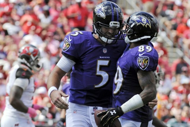 Joe Flacco (5) et Steve Smith (89) célèbrent... (PHOTO DAVID MANNING, USA TODAY)