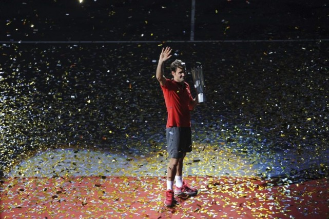 Roger Federer... (PHOTO GOH CHAI HIN, AFP)
