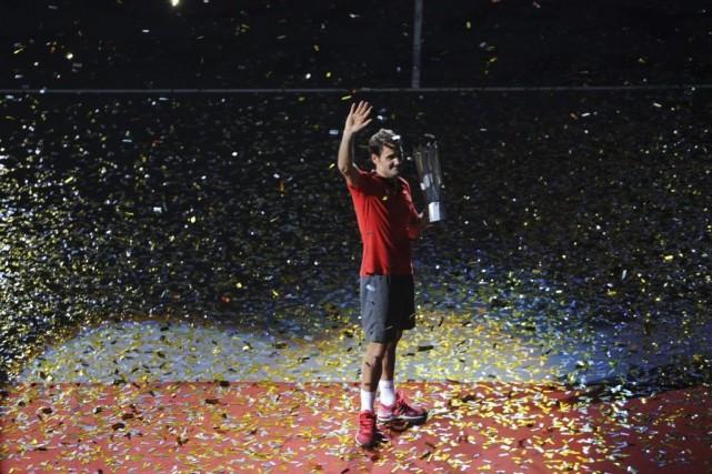 Roger Federer... (PHOTO GOH CHAI HIN, AFP)