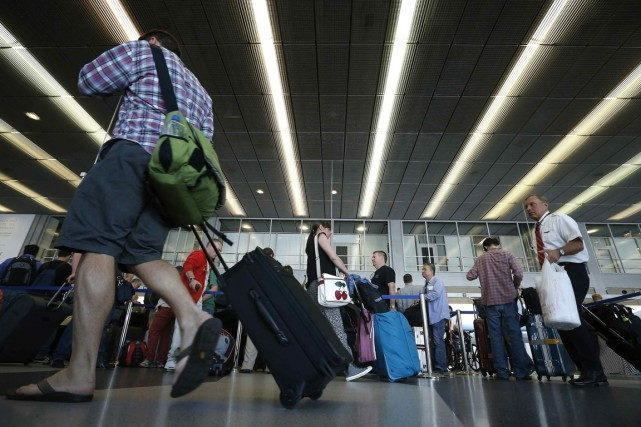 L'aéroport de O'Hare accueille 67 millions de passagers... (Photo Jim Young, Reuters)
