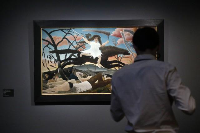 Un toile d'Henri Rousseau exposée dans le cadre... (PHOTO FRANCOIS GUUILLOT, AFP)