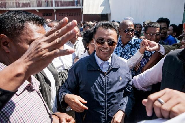 Marc Ravalomanana est mystérieusement rentré à Madagascar dimanche... (PHOTO RIJASOLO, AFP)