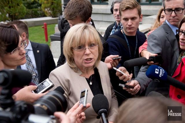 La ministre de la Famille, Francine Charbonneau, indiquait... (La Presse Canadienne, Jacques Boissinot)