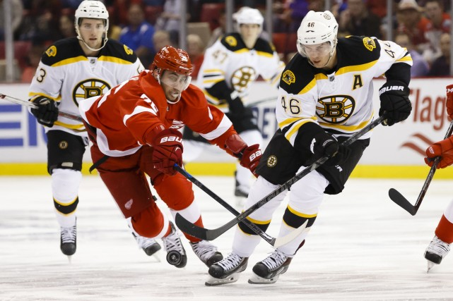 David Krejci et Reilly Smith ont marqué en temps régulier et en fusillade,... (Photo Rick Osentoski, USA Today Sports)