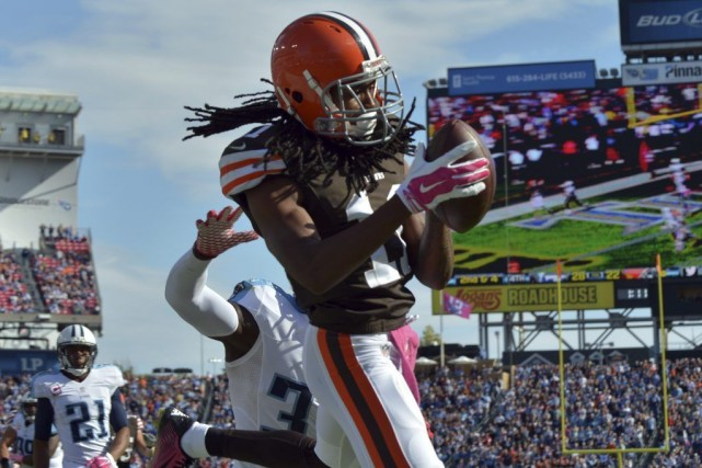 Travis Benjamin (11) marque le touché qui a... (PHOTO DON MCPEAK, USA TODAY)
