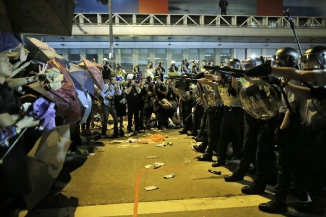 Il s'agit de la quatrième nuit consécutive de... (Photo Vincent Yu, AP)