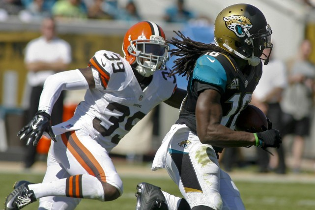 Denard Robinson (à droite)... (Photo Phil Sears, USA Today Sports)