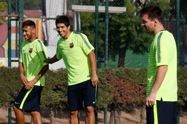 Neymar, Luis Suarez et Lionel Messi à l'entraînement... (Photo Albert Gea, Reuters)