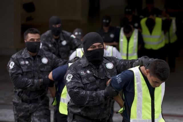 La police fédérale a arrêté des suspects en... (Archives AP)