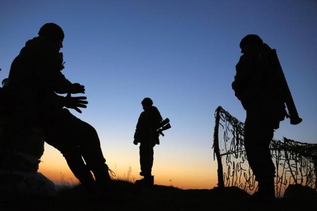 Tout comme les rebelles prorusses, les forces ukrianiennes... (PHOTO YANNIS BEHRAKIS, ARCHIVES REUTERS)
