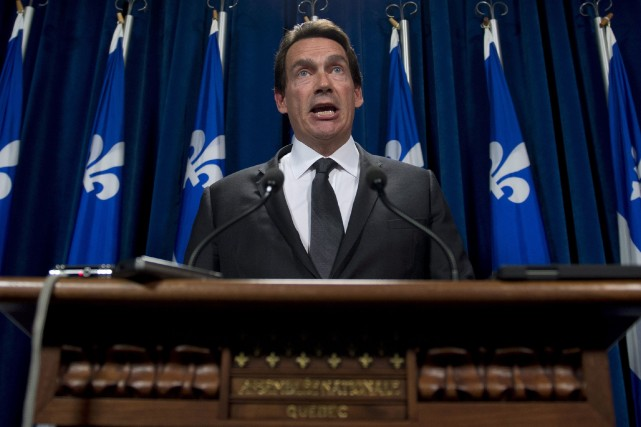 Le député du PQ Pierre Karl Péladeau se défend... (Photo Jacques Boissinot, archives La Presse Canadienne)