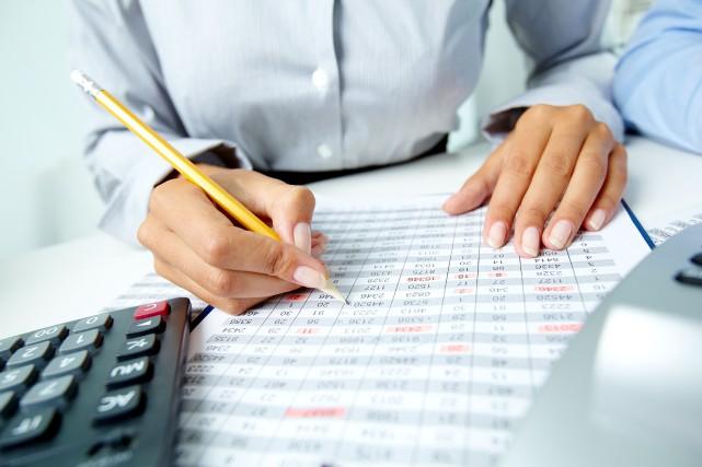 Vérification, services financiers, consultations auprès d'une entreprise du... (Photo Shutterstock, Pressmaster)