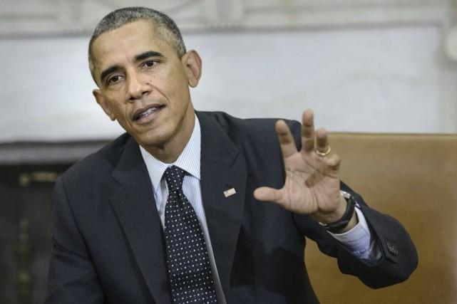 Barack Obama a exprimé la solidarité des États-Unis... (PHOTO BRENDAN SMIALOWSKI, AGENCE FRANCE-PRESSE)