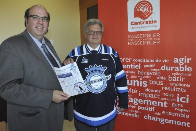 Martin St-Pierre, directeur général de Centraide, et le... ((Photo Michel Tremblay))