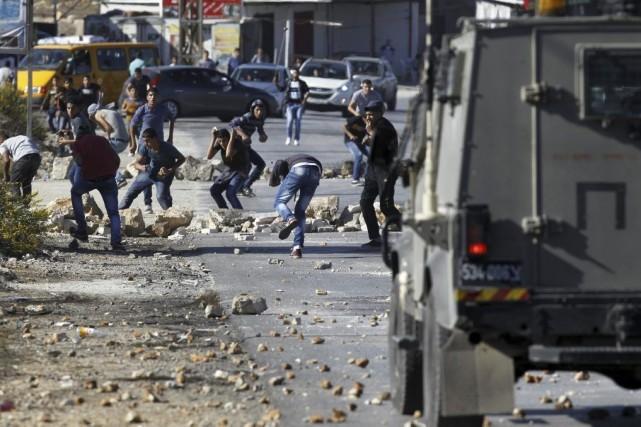 De jeunes Palestiniens ont affronté les forces de... (PHOTO ABBAS MOMANI, AFP)