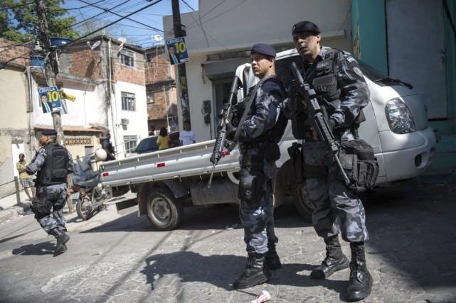 Dimanche, 20788 policiers au total assureront la sécurité... (PHOTO YASUYOSHI CHIBA, AFP)