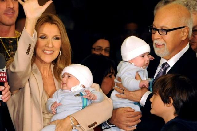 Céline Dion, en compagnie de ses jumeaux, Eddy... (Archives, Agence France-Presse)