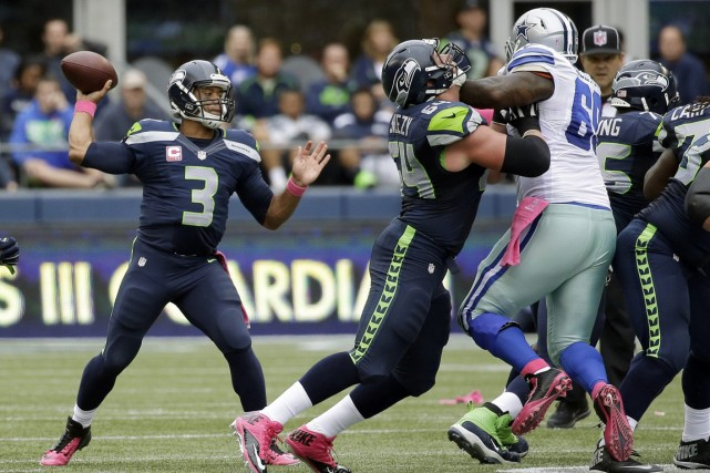 Champions en titre du Super Bowl, les Seahawks... (Photo Elaine Thompson, AP)