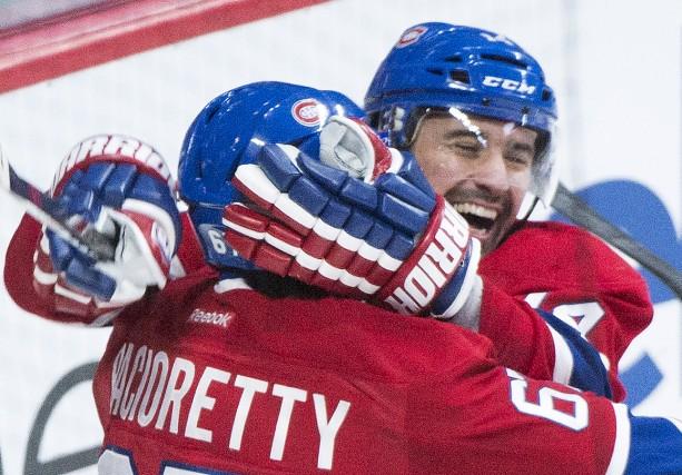 Tomas Plekanec et Max Pacioretty fiers après un... (La Presse Canadienne)