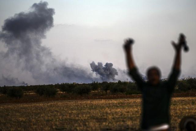 Au total, la coalition menée par les États-Unis... (Photo BULENT KILIC, AFP)